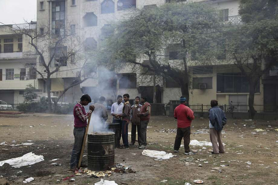 Indians burn the leftover food after a wedding in New Delhi, India, Wednesday, Feb. 5, 2014. New Delhi's worsening air pollution has drawn comparisons with Beijing, the world's pollution poster child.  (AP Photo/Tsering Topgyal) Photo: Tsering Topgyal, Associated Press