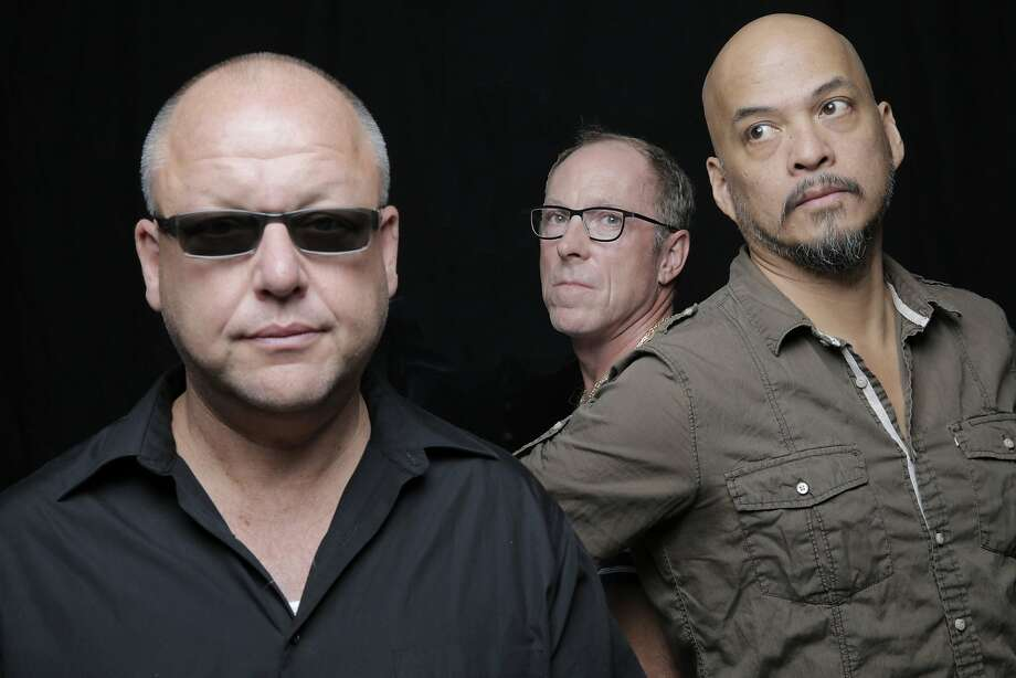 Original Pixies members Black Francis (left), David Lovering and Joey Santiago have a new bassist. Photo: Michael Halsband