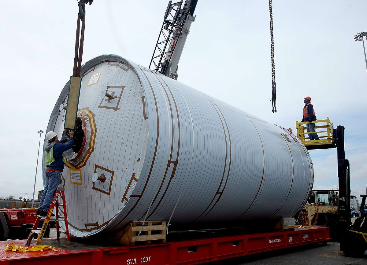 Dockworkers remove the riggings from a fermentation tank after offload in Mills River, N.C..