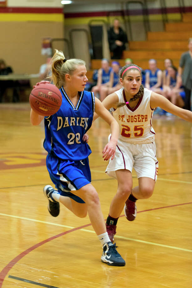 Darien's Kelly Karczewski (20) controls the ball as St. Joseph's Maite Gritsko (25) defends during the girls basketball game at St. Joseph's High School in Trumbull on Tuesday, Feb. 4, 2014. Photo: Amy Mortensen / Connecticut Post Freelance
