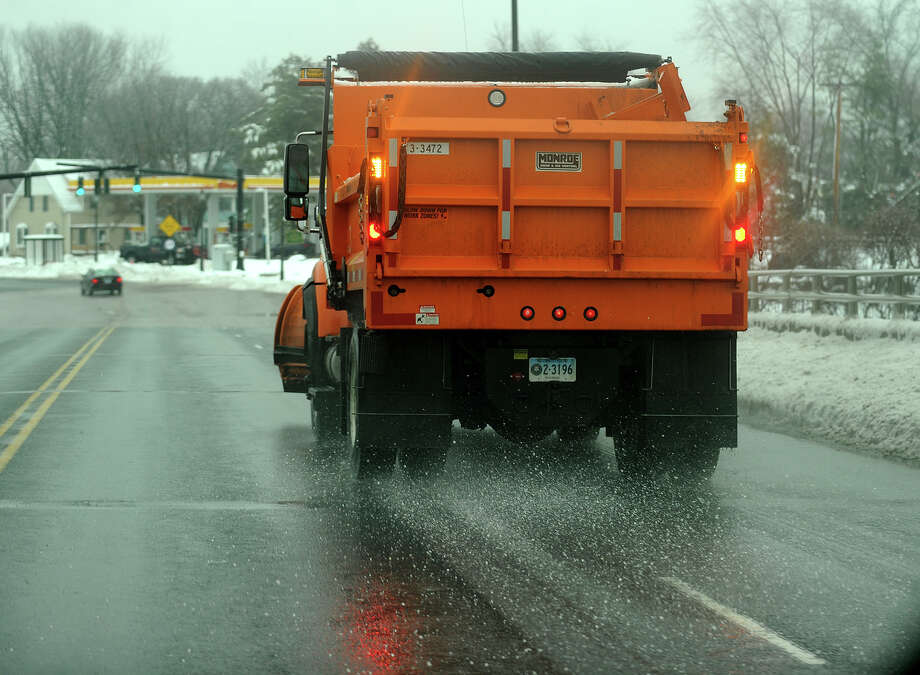 A plow truck spreads road salt on Bridgeport Avenue in Milford, Conn. on Wednesday, February 5, 2014. Photo: Brian A. Pounds / Connecticut Post