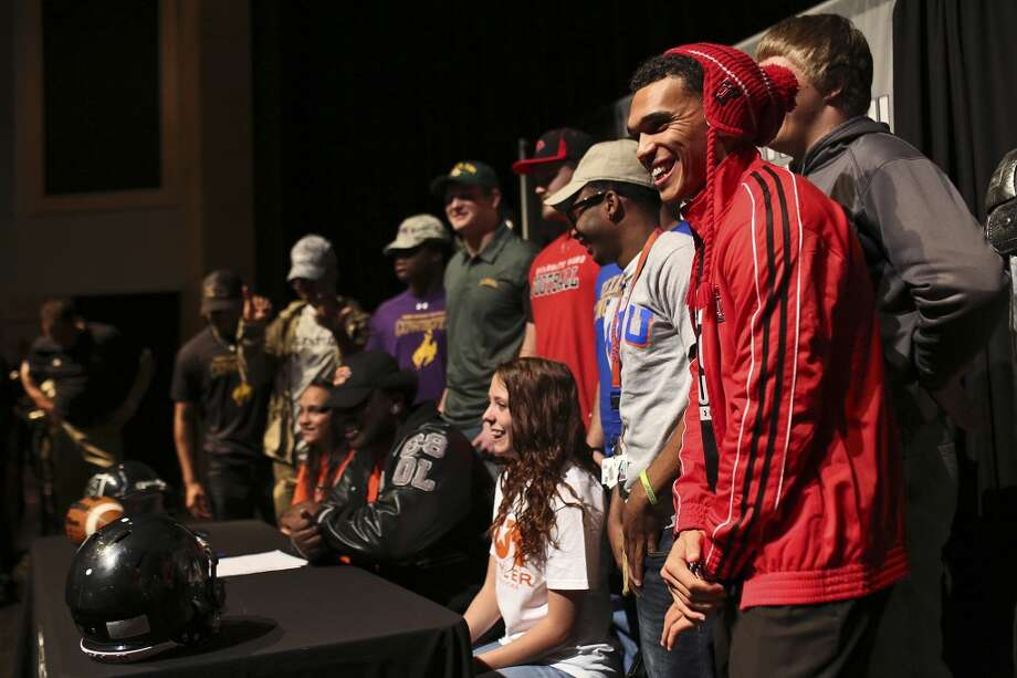 Justin Stockton celebrates with other players who signed with various schools after signing to play football for Texas Tech on National Signing Day at Steele High School in Cibolo on Wednesday, Feb. 5, 2014. Photo: Lisa Krantz