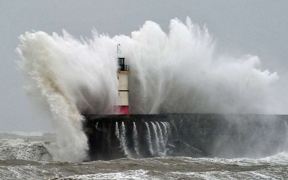 Beacon blitz: A huge wave crashes against the Newhaven Lighthouse during a storm on the southern coast of England. Photo: Glyn Kirk, AFP/Getty Images
