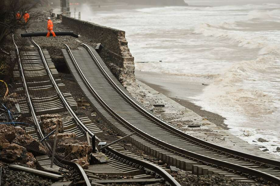 Track bed washed away:High tides and strong winds collapsed a sea wall in Dawlish, England, undermining the railroad tracks that sit on it. The winter storm disrupted road and rail networks, damaged coastal properties and left thousands without power. Photo: Ben Birchall, Associated Press