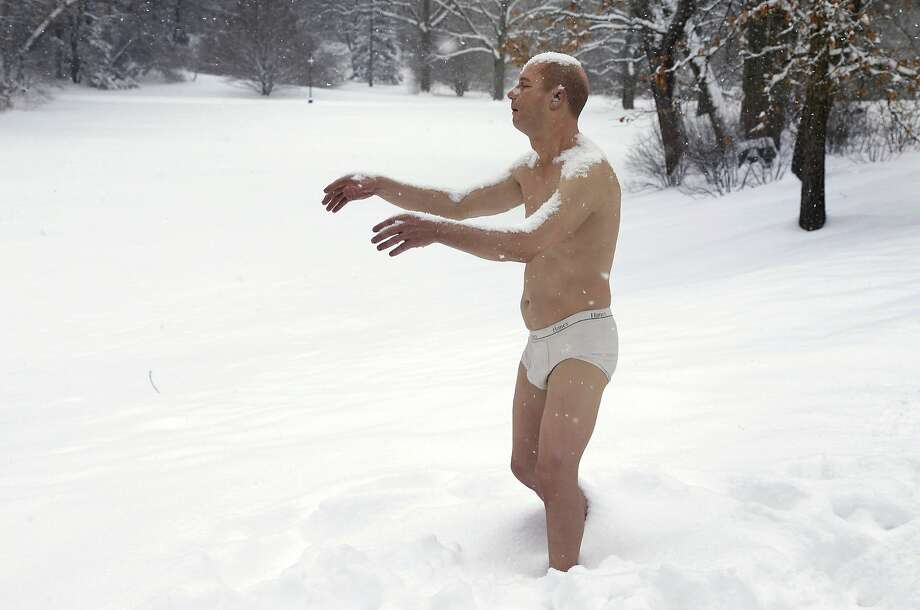 "Pantsless in Massachusetts:Snow accumulates on the ""Sleepwalker,"" part of an exhibit by sculptor Tony Matelli, at Wellesley College's Davis Museum in Wellesley, Mass. Photo: Steven Senne, Associated Press"