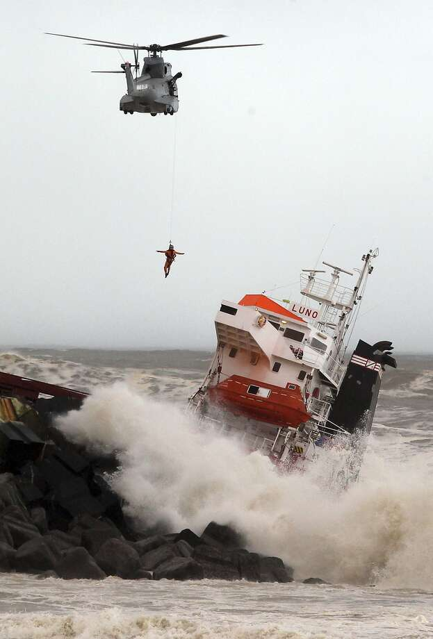 Cargo ship splits in two: A helicopter lowers a rescue worker into a Spanish cargo ship that slammed into a jetty and broke in two in rough seas off Anglet, France. Twelve sailors were rescued from the ship with one suffering from injuries. The ship had been heading to a nearby port to load up with cargo when its engine failed, and the waves carried it into the jetty. Officials feared it was leaking fuel. Photo: Bob Edme, Associated Press