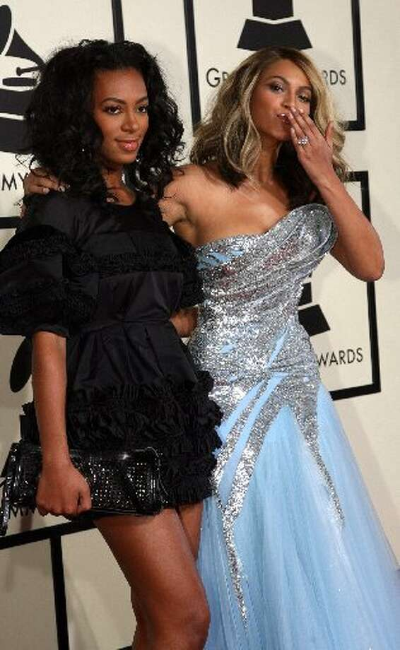 With sister Solange, a singer and DJ. (Gabriel Bouys/AFP/Getty Images)