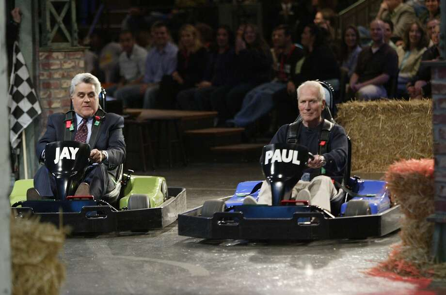 Avid car enthusiasts unite! Paul Newman and Jay Leno get behind the wheel during a Tonight Show car race on April 06, 2006. Photo: Nbc, NBC Via Getty Images
