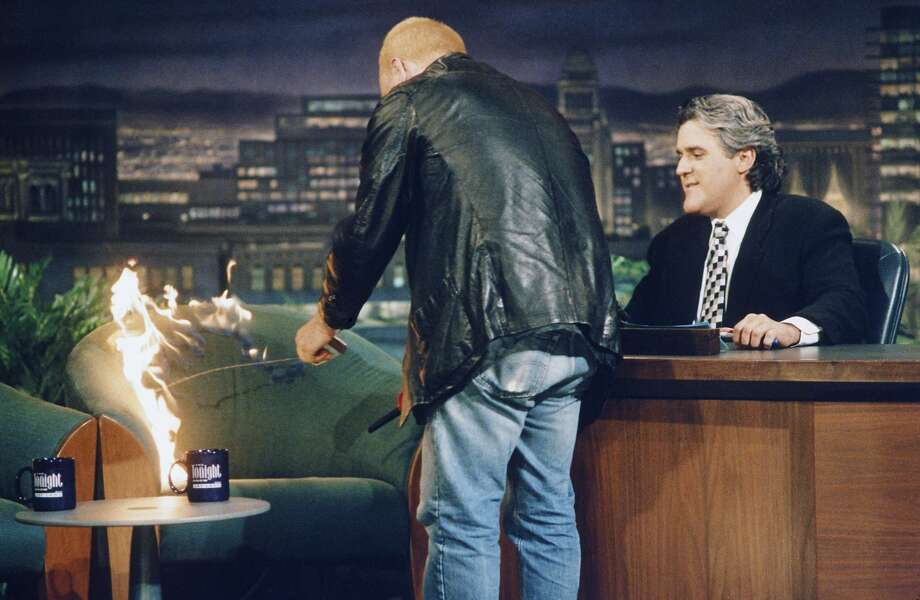 Actor/comedian Bobcat Goldthwait lights the chair on fire during an interview with Jay Leno on May 6, 1994.  Photo: Nbc, Margaret Norton/NBCU Photo Bank