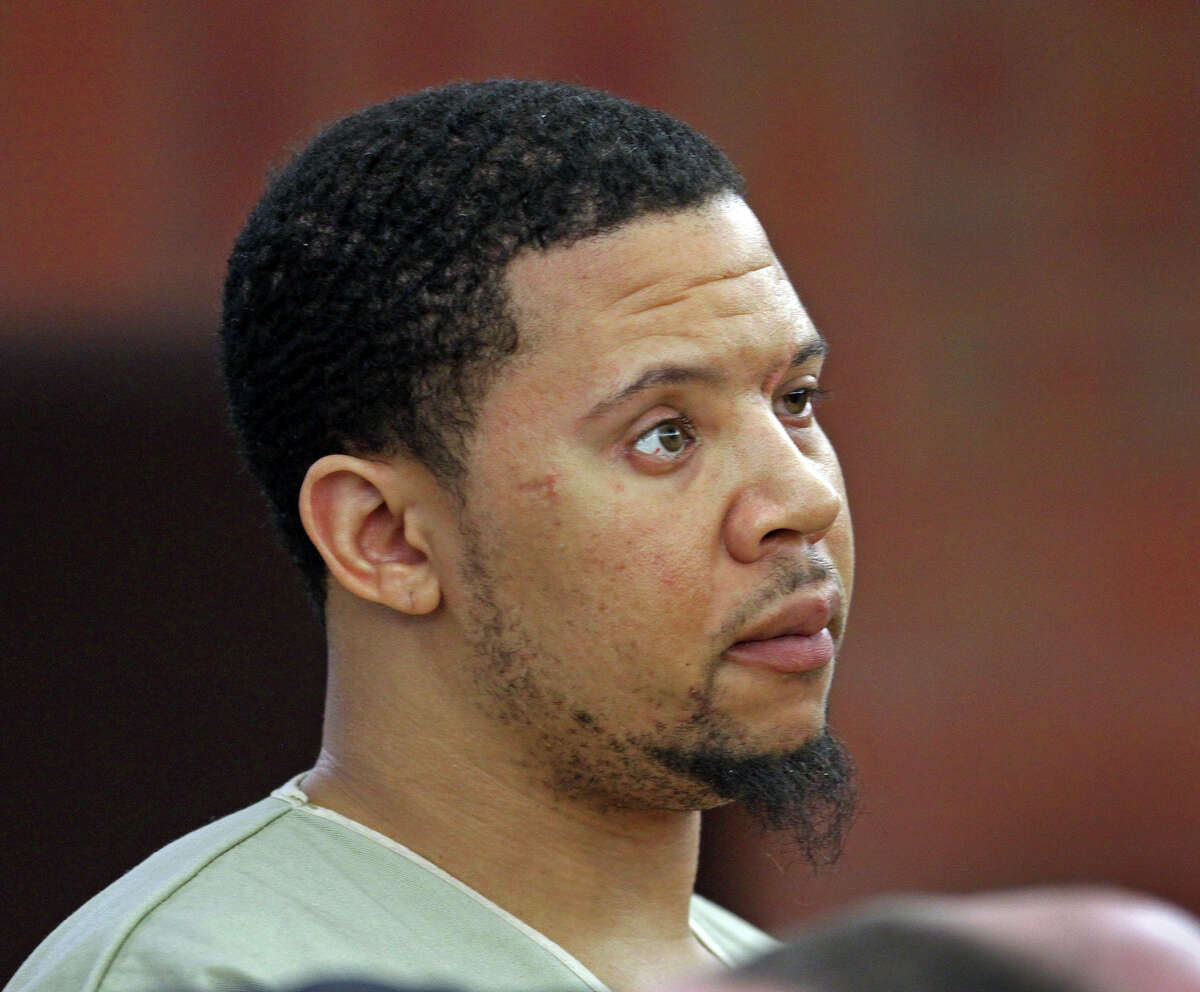 Alexander Bradley, an associate of former New England Patriots football player Aaron Hernandez, stands during arraignment on weapons charges Tuesday, Feb. 4, 2014, in Superior Court in Hartford, Conn. A handgun used by Bradley came from a truckload of guns hijacked by Kashawn Brown, a Bridgeport man in Stratford in 2012.