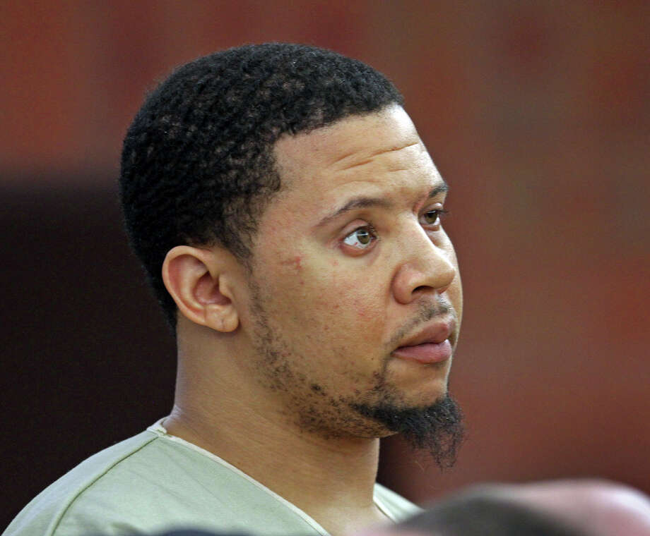 Alexander Bradley, an associate of former New England Patriots football player Aaron Hernandez, stands during arraignment on weapons charges Tuesday, Feb. 4, 2014, in Superior Court in Hartford, Conn. A handgun used by Bradley came from a truckload of guns hijacked by Kashawn Brown, a Bridgeport man in Stratford in 2012. Photo: AP Photo/Boston Herald, Nancy Lane / Associated Press