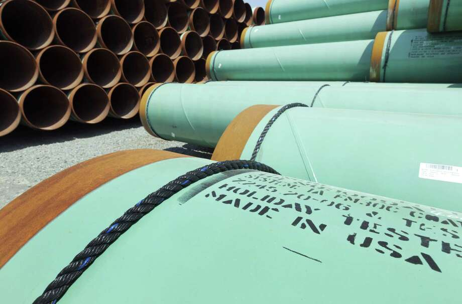 Some of about 500 miles worth of coated steel pipe  for the Keystone oil pipeline is stored in Little Rock, Ark. Due to the president's stalling tactics, the pipe may be stored for a long time. Photo: Danny Johnston / Associated Press / AP