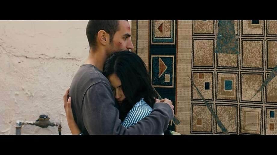 "Adam Bakri and Leem Lubany share a troubled embrace in contested territory in ""Omar"" Photo: Adopt Films"