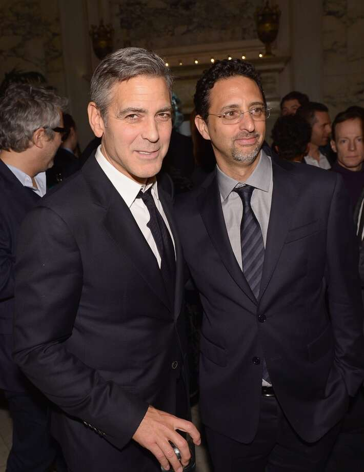 "Actor George Clooney (L) and producer Grant Heslov attend the after party following the ""Monuments Men"" premiere at The Metropolitain Club on February 4, 2014 in New York City. Photo: Michael Loccisano, Getty Images"