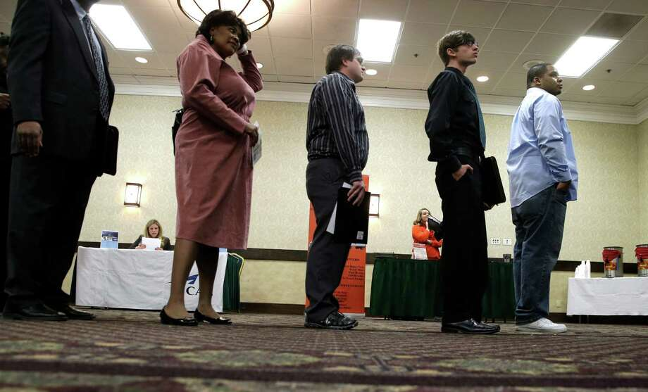 In this Wednesday, Jan. 22, 2014, photo, job seekers line up to meet a prospective employer at a career fair at a hotel in Dallas. Payroll processor ADP reports on job growth at U.S. companies in January on Wednesday, Feb. 5, 2014. (AP Photo/LM Otero)  ORG XMIT: NYBZ144 Photo: LM Otero / AP