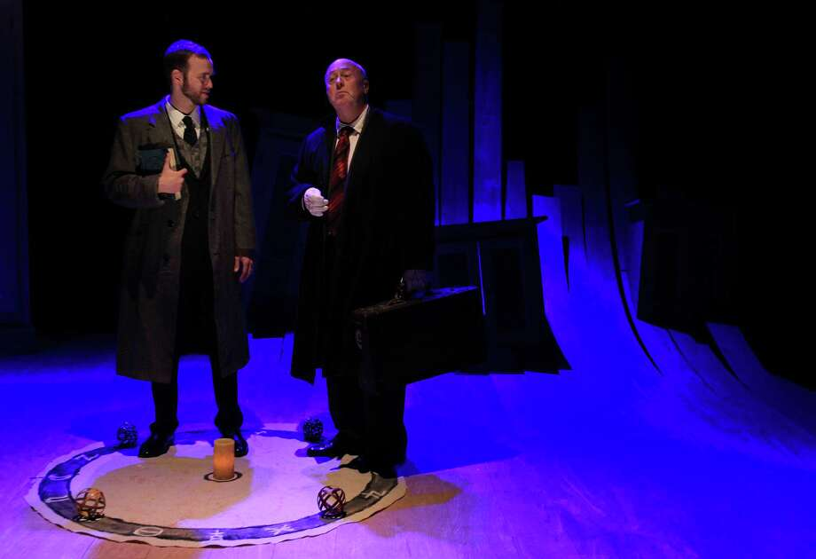 """Adam Gibbs, as 'Faustus', and James Belcher, plays Mephistopheles, perform in the Classical Theatre Company production of Christopher Marlowe's """"Doctor Faustus"""" on Tuesday, Jan. 28, 2014, in Houston. ( Mayra Beltran / Houston Chronicle ) Photo: Mayra Beltran, Staff / © 2013 Houston Chronicle"""