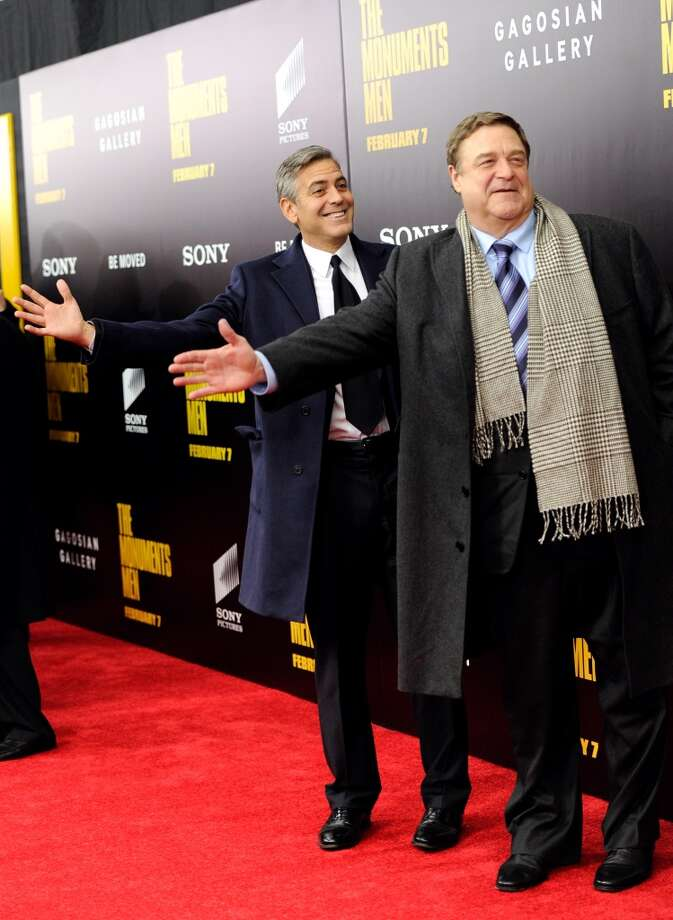 "Director and actor, George Clooney, left, and actor John Goodman attend the premiere of ""The Monuments Men"" at the Ziegfeld Theatre on Tuesday, Feb. 4, 2014, in New York. Photo: Evan Agostini, Associated Press"