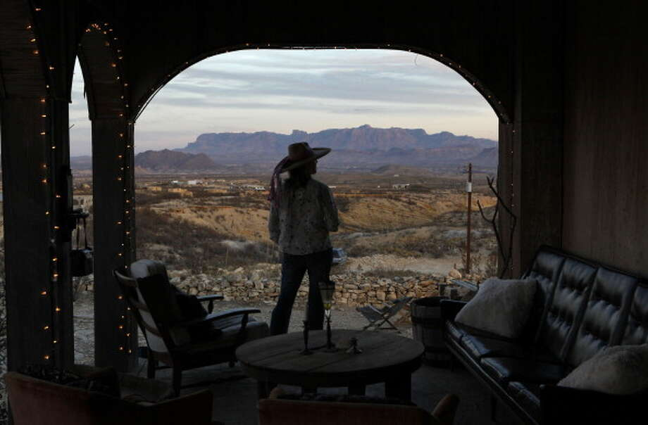 TERLINGUA, TX - JANUARY, 15 -  Kaci Fullwood takes in the view of the Chisos Mountains on the porch of the Terlingua, Texas boutique hotel, Upstairs at the Mansion, Sunday Janurary 15, 2012. (Photo by Erich Schlegel/For The Washington Post via Getty Images) Photo: The Washington Post, The Washington Post/Getty Images / 2011 The Washington Post