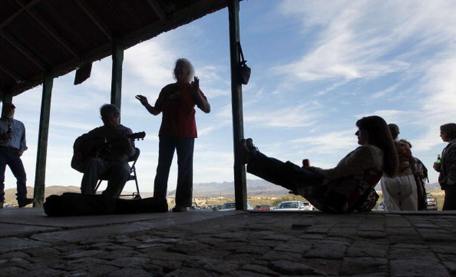 TERLINGUA, TX - JANUARY, 15 -  Afternoon scene of music and beer drinking on the porch of the Terlingua Trading Co. in Terlingua, Texas Sunday Janurary 15, 2012. (Photo by Erich Schlegel/For The Washington Post via Getty Images) Photo: The Washington Post, The Washington Post/Getty Images / 2011 The Washington Post