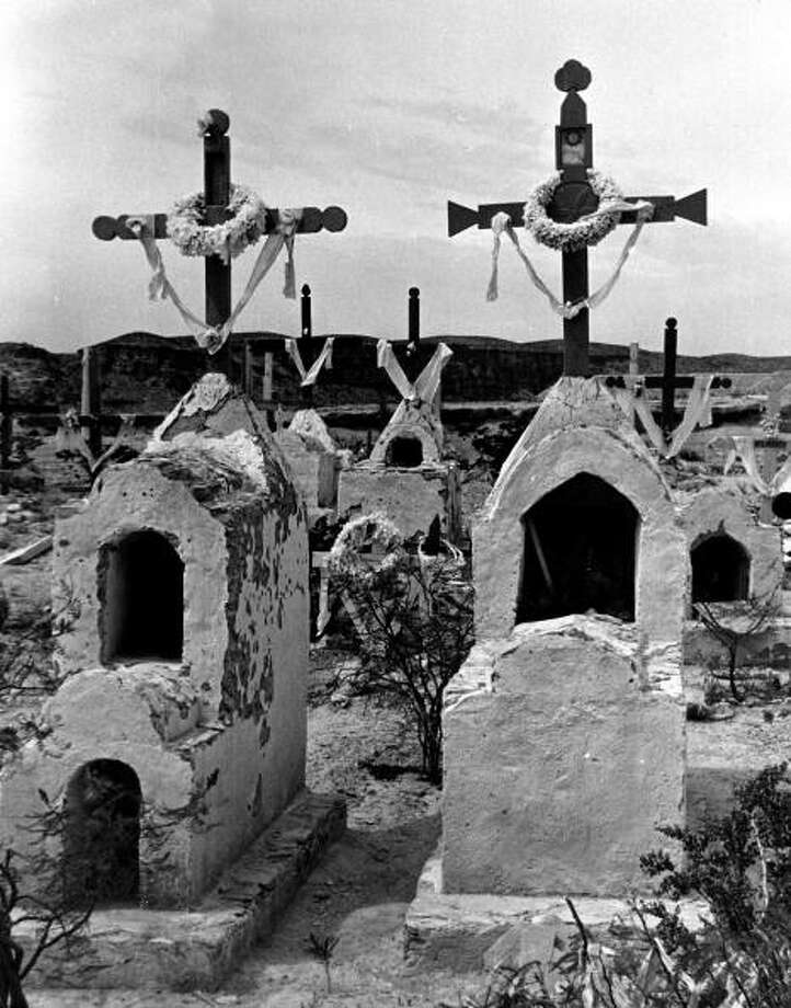 A view showing tombstones in the quicksilver mining town of Terlingua.  (Photo by Carl Mydans//Time Life Pictures/Getty Images) Photo: Carl Mydans, Time & Life Pictures/Getty Image / Time Life Pictures