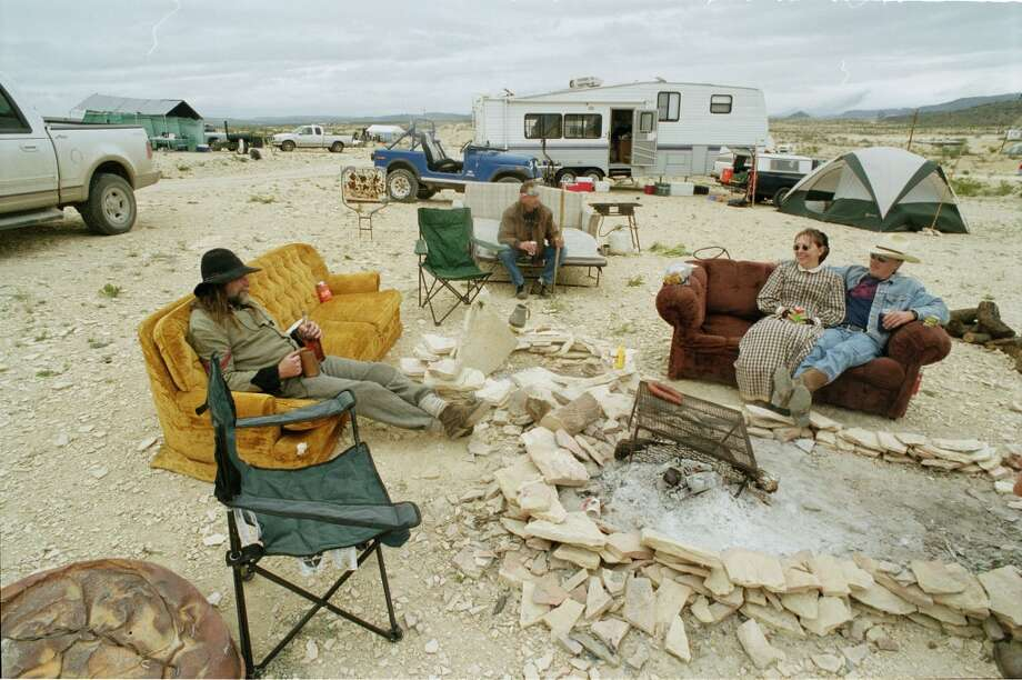 The Couch Guys Camp a chili cook-off team sit on couches they purchase from a thrift store in Uvalde, have the set in the Championship Chili Cook-Off in Terlingua.  11/01/2002  (E. Joe Deering/Chronicle).  Photo: Houston Chronicle