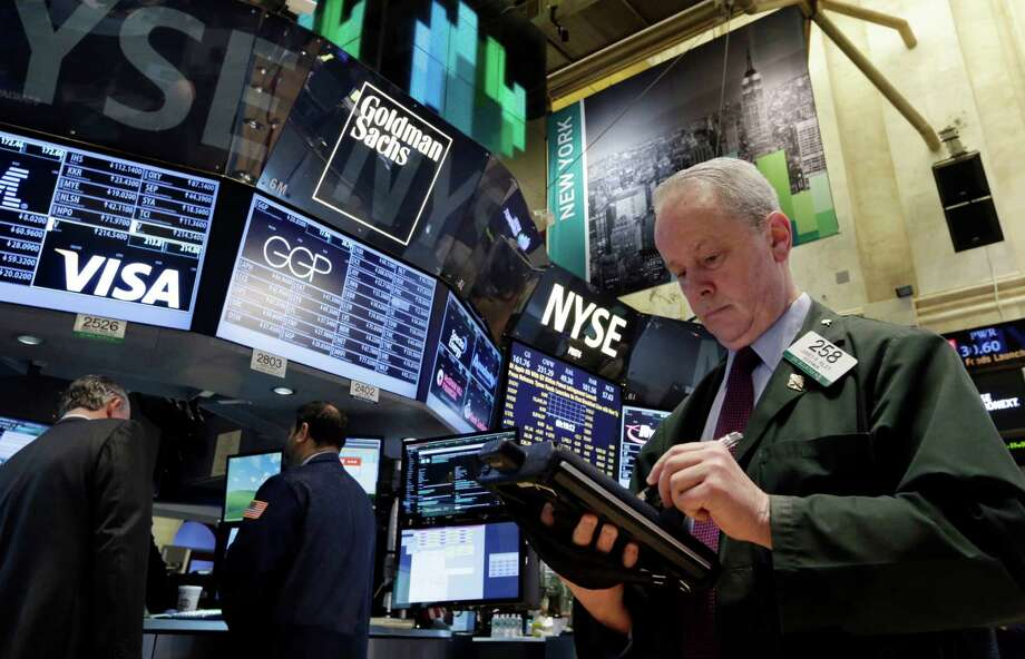 Trader James Riley works on the floor of the New York Stock Exchange Wednesday, Feb. 5, 2014. The U.S. stock market is edging lower in early trading after a modest recovery the day before. (AP Photo/Richard Drew) ORG XMIT: NYRD104 Photo: Richard Drew / AP