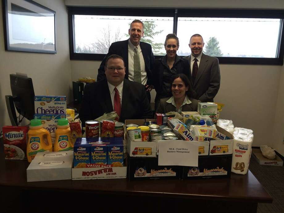Enterprise Holdings employees, standing (L to R): Ed Keefe, Controller, Anna De Rubertis, Staff Accountant, Robert Stodgell, Accounting Assistant. Seated: Craig Murphy, Accounting Supervisor and Nicole D'Amario, Staff Accountant. (Provided photo)