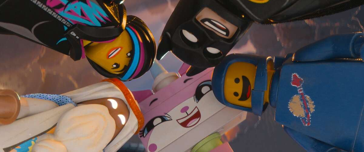 """(Clockwise, l-r) LEGO characters Vitruvius (voiced by MORGAN FREEMAN), Wyldstyle (ELIZABETH BANKS), Batman (WILL ARNETT), Benny (CHARLIE DAY) and Unikitty (ALISON BRIE) in the 3D computer animated adventure """"The LEGO Movie,"""" from Warner Bros. Pictures, Village Roadshow Pictures and Lego System A/S. A Warner Bros. Pictures release."""