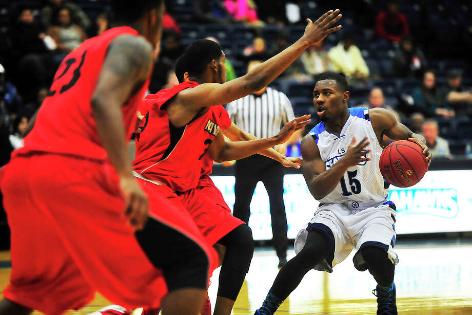Lamar State College Seahawks Charles Bennett III, No. 15, looks for an open teammate during Thursday's game against Navarro College at Port Arthur College. Michael Rivera/@michaelrivera88   Photo taken Thursday, 01/08/14