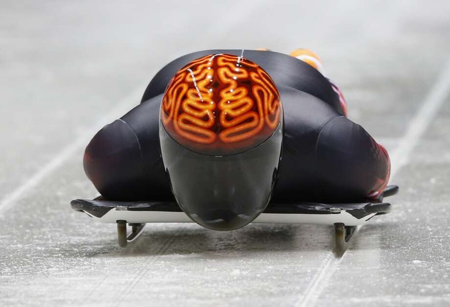 Canada's John Fairbairn is a heavy favorite for gold medal in the coolest skeleton helmet category at this year's Sochi Olympics. The neon brain helmet is brilliant and really shines with his near all-black suit. (Murad Sezer/Reuters) Photo: MURAD SEZER, Reuters
