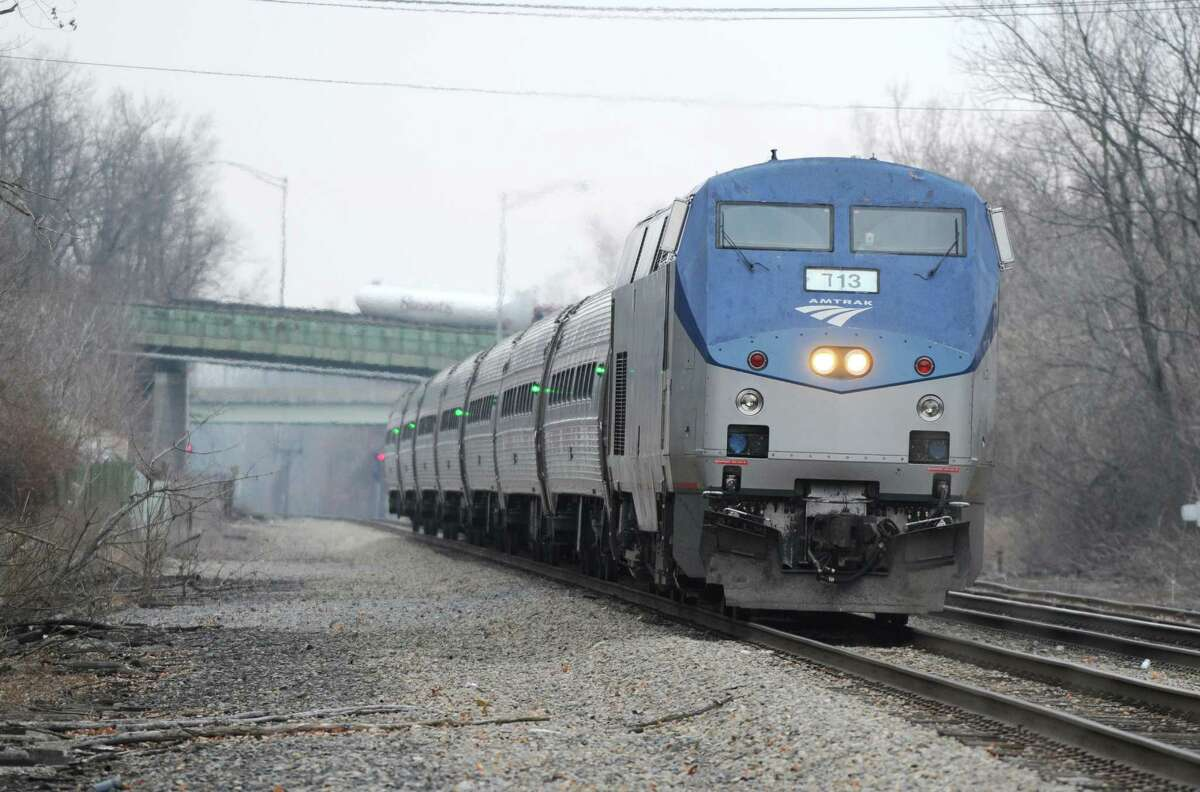 A northbound Amtrak train pulls into the Albany-Rensselaer station Monday afternoon, Dec. 2, 2013, in Rensselaer, N.Y. (Will Waldron/Times Union)