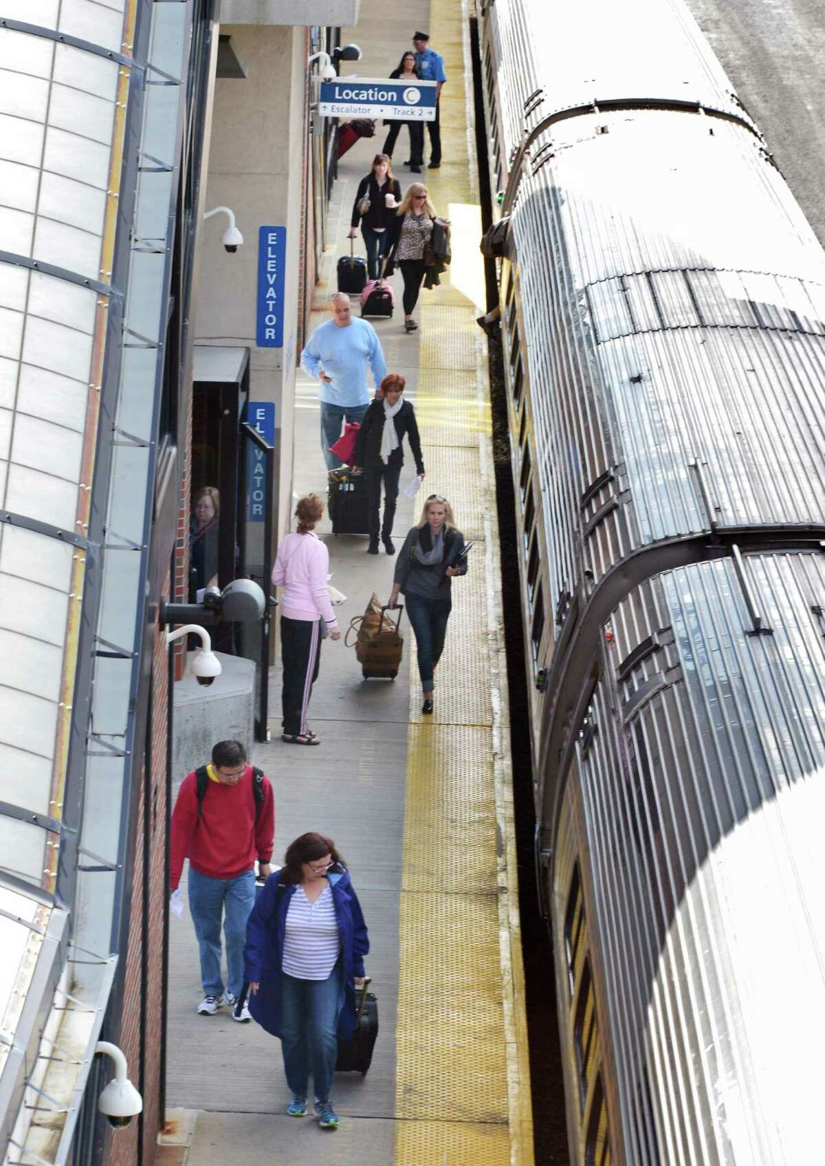 Passengers board a NYC bound Amtrak train at the Albany-Rensselaer Station Thursday Sept. 26, 2013, in Rensselaer,NY. (John Carl D'Annibale / Times Union)