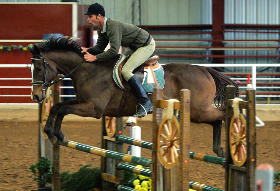 John De Leyer, atop of Klein, competes in the Jumper Division at the San Antonio Rose Palace. The San Antonio Charity Hunters & Jumpers contest is this weekend. Photo: Express-News File Photos / SAN ANTONIO EXPRESS-NEWS