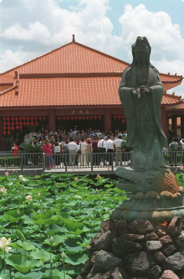 The Jade Buddha Temple in Houston, Texas was introduced in 1990. The temple includes a grand hall for weekly services, a smaller meditation hall, youth activity center, library, cafeteria and a lotus pond, foreground, with a statue of the bodhisattva, Kwan-Yin, as its centerpiece. (Craig H. Hartley / Houston Chronicle) Photo: Craig H. Hartley, SPECIAL TO THE CHRONICLE