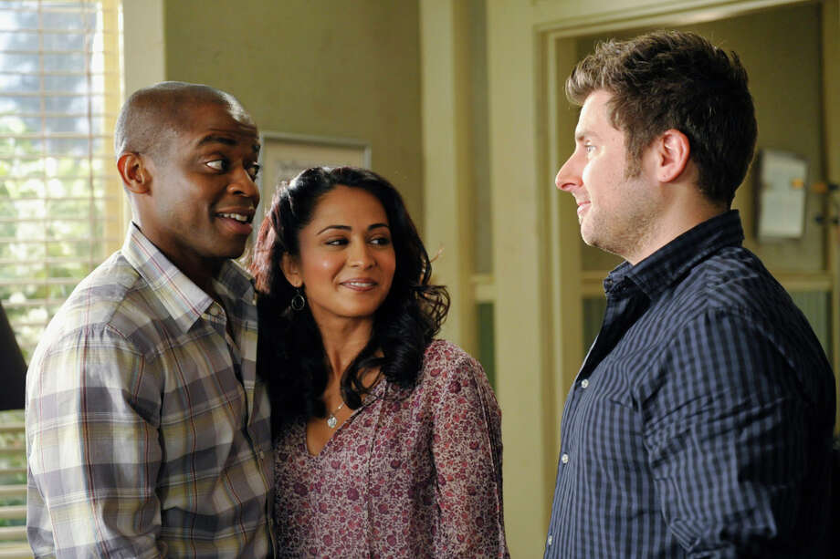 """Juliet Takes a Luvvah"" Episode 702 -- Pictured: (l-r) Dule Hill as Gus ""Gus"" Guster, Parminder Nagra as Rachael, James Roday as Shawn Spencer. Photo: Alan Zenuk, USA Network/NBCU Photo Bank / 2013 USA Network Media, LLC"