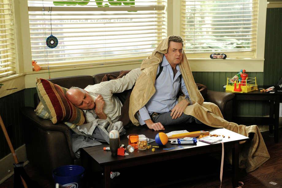 """Last Night Gus"" Episode 604 -- Pictured: (l-r) Kurt Fuller as Woody (Coroner), Timothy Omundson as Carlton Lassiter. Photo: Alan Zenuk, NBC/NBCU Photo Bank / © USA Network"