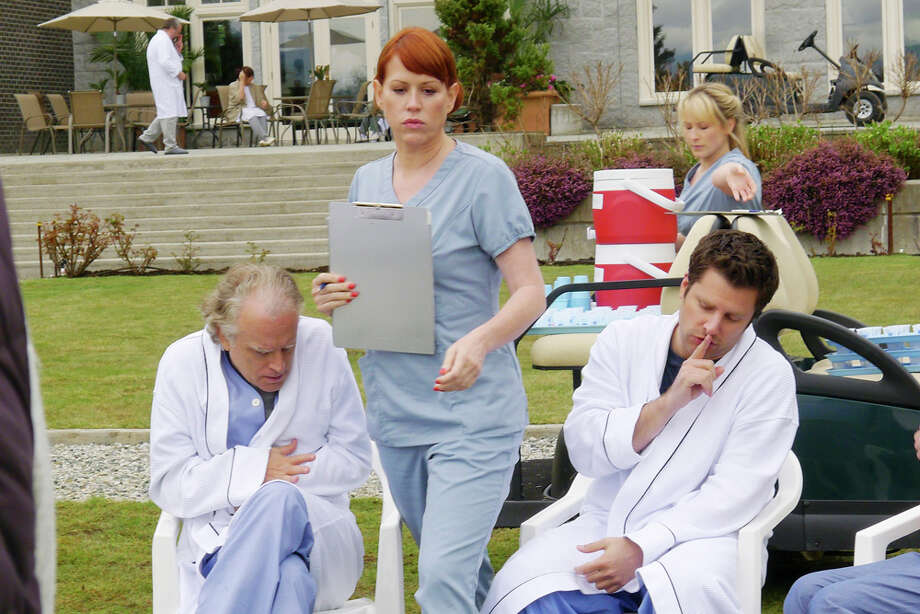 """Shawn, Interupted"" Episode 605 -- Pictured: (l-r) Brad Dourif as Bernie Bethel, Molly Ringwald as Nurse McElroy,  James Roday as Shawn Spencer. Photo: Alan Zenuk, USA Network/NBCU Photo Bank / © USA Network"
