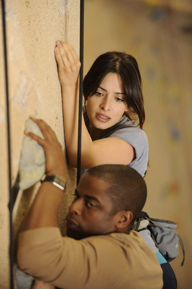 """Thrill Seekers & Hell Raisers"" Episode 4014 -- Pictured: (l-r) Dule Hill as Gus Guster, Sarah Shahi as Ruby. Photo: NBC, NBC Via Getty Images"