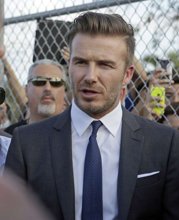 Retired soccer player David Beckham talks to fans during a visit at Kendall Soccer Park as he greets South Florida soccer fans and players in Miami, Wednesday, Feb. 5, 2014. Earlier, Beckham confirmed he has exercised his option to purchase a Major League Soccer expansion franchise in Miami. The deal will be finalized when the former English national team captain can secure a financing plan and location for a new stadium. (AP Photo/Alan Diaz) Photo: Alan Diaz, Associated Press