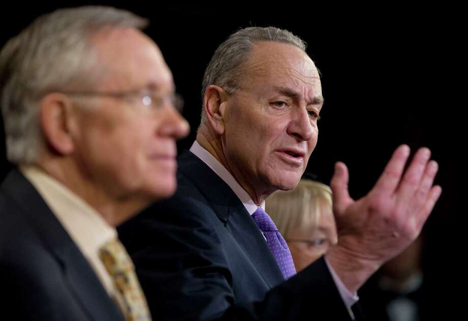 Sen. Charles Schumer, D-N.Y., center, accompanied by Senate Majority Leader Harry Reid of Nev., left, and Sen. Patty Murray, D-Wash., right, speaks during a news conference about extending unemployment insurance benefits which expired Dec. 28, Thursday, Jan. 9, 2014, on Capitol Hill in Washington. Reid is leading the effort in the Senate to reauthorize the benefits for three months. (AP Photo/Pablo Martinez Monsivais) ORG XMIT: DCPM110 Photo: Pablo Martinez Monsivais / AP