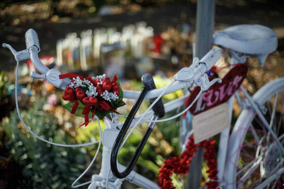 The bike memorial for Chelsea Norman, 24, who was killed Dec. 1, 2013, near the corner of Waugh and West Gray as she rode home from her job at Whole Foods. Photo: Michael Paulsen, Houston Chronicle / © 2014 Houston Chronicle