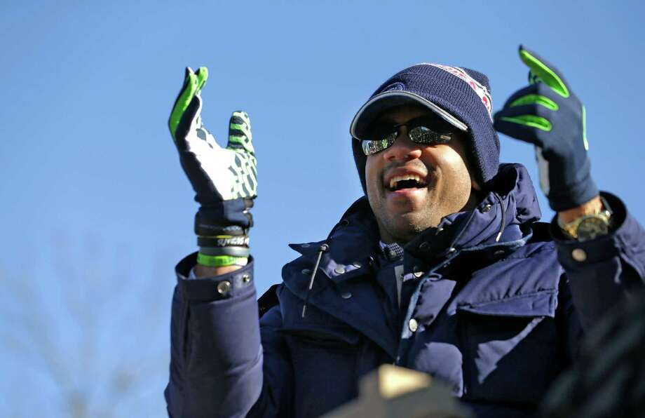 Seattle Seahawks quarterback Russell Wilson applauds fans during a parade for the NFL football Super Bowl champions Wednesday, Feb. 5, 2014, in Seattle. The Seahawks defeated the Denver Broncos 43-8 on Sunday. (AP Photo/Elaine Thompson) ORG XMIT: WAET109 Photo: Elaine Thompson / AP