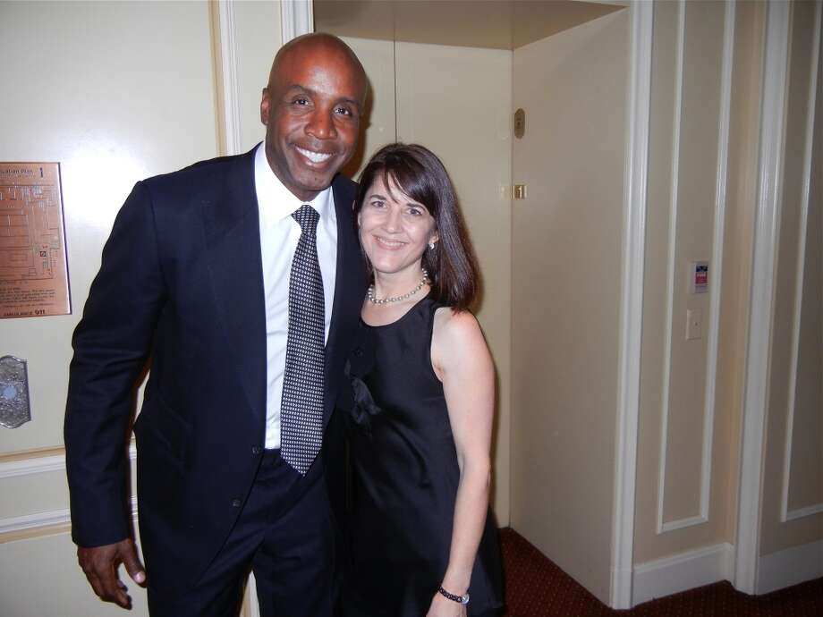 Former Giants slugger Barry Bonds and SF Giants Community Fund Director Sue Petersen at the Ritz-Carlton for the Guardsmen Sports Auction fundraiser. Photo: Catherine Bigelow, Special To The Chronicle