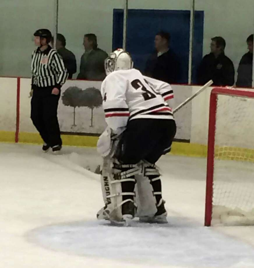 New Canaan senior goalie Mac Wright prepares for an oncoming Green Knight rush in the first period. Staff Photo / Andrew Callahan Photo: Contributed Photo, Contributed / New Canaan News Contributed