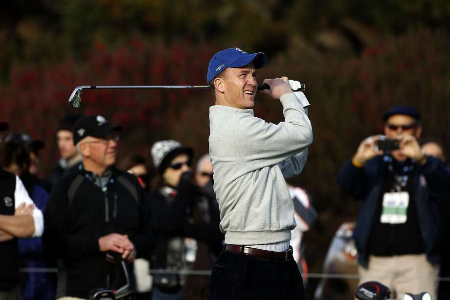 Peyton Manning takes a shot at No. 1 at Pebble Beach, days after his Broncos lost the Super Bowl. Photo: Michael Macor, The Chronicle