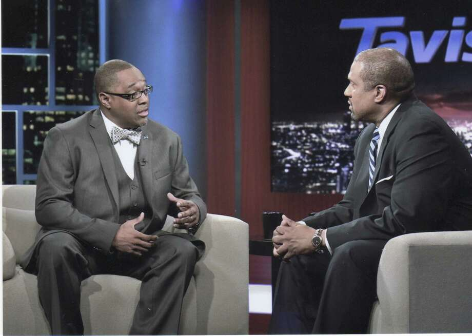 Kenneth Braswell, left, appears on the Tavis Smiley show.