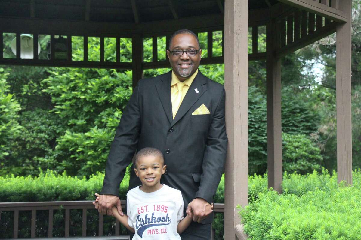 Kenneth Braswell and son Kenneth Jr.