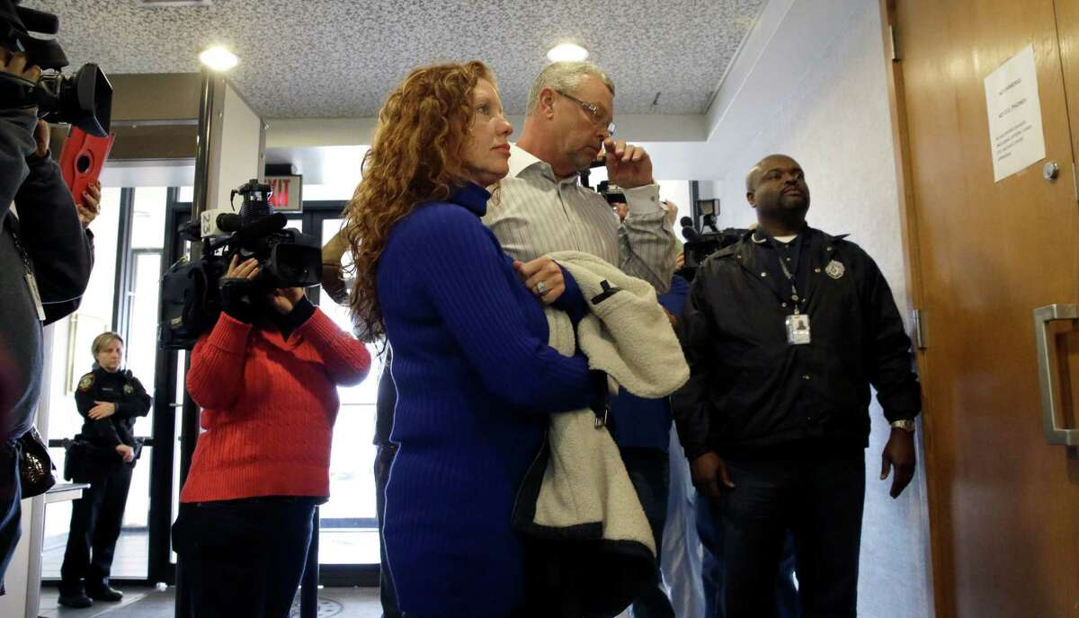 Tonya Couch, left, and Fred Couch, parents of teenager Ethan Couch, arrive at juvenile court for a hearing about their son's future Wednesday, Feb. 5, 2014, in Fort Worth, Texas. Judge Jean Boyd again decided to give no jail time for Ethan Couch, who was sentenced to 10 years' probation in a drunken-driving crash that killed four people, and ordered him to go to a rehabilitation facility paid for by his parents. The sentence stirred fierce debate, as has the testimony of a defense expert who says Couch's wealthy parents coddled him into a sense of irresponsibility. The expert termed the condition