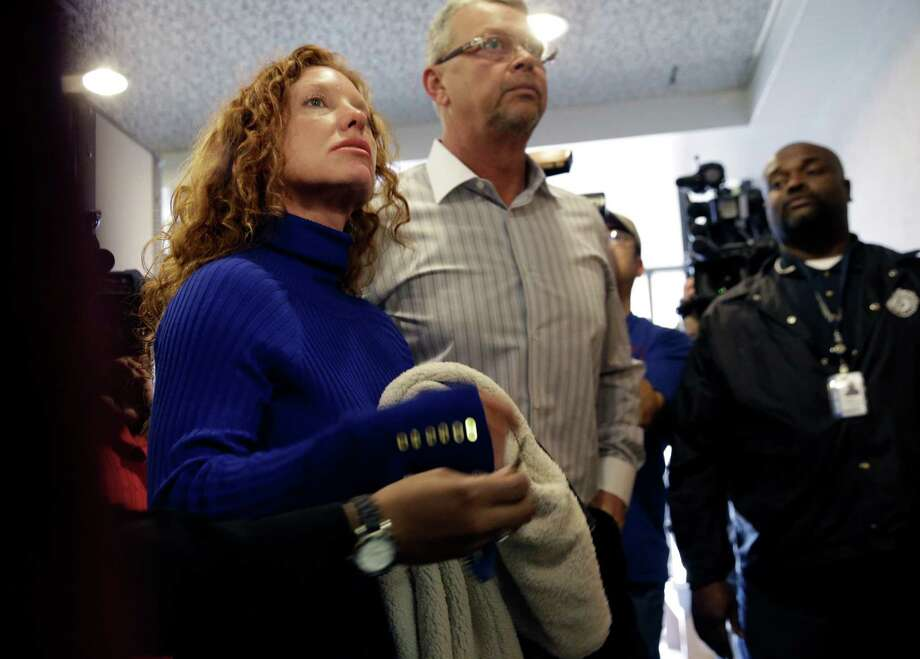 "Tonya Couch, left, and Fred Couch, parents of teenager Ethan Couch, arrive at juvenile court for a hearing about their son's future Wednesday, Feb. 5, 2014, in Fort Worth, Texas. Judge Jean Boyd again decided to give no jail time for Ethan Couch, who was sentenced to 10 years' probation in a drunken-driving crash that killed four people, and ordered him to go to a rehabilitation facility paid for by his parents. The sentence stirred fierce debate, as has the testimony of a defense expert who says Couch's wealthy parents coddled him into a sense of irresponsibility. The expert termed the condition ""affluenza."" (AP Photo/LM Otero) Photo: LM Otero, STF / AP"