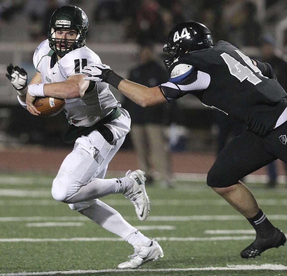 Reagan's Ty Summers, a TCU linebacker signee, runs from Steele's Josh Malin, a Baylor defensive end signee, on Nov. 22. Photo: Kin Man Hui / San Antonio Express-News / ©2013 San Antonio Express-News